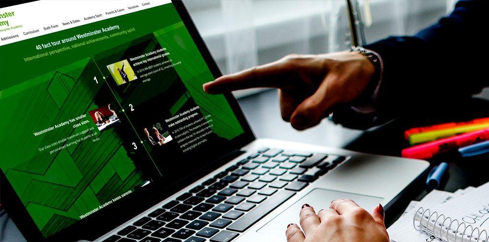 Westminster Academy website timeline on a laptop